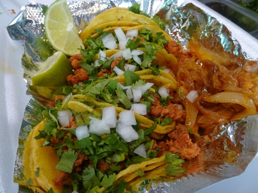 Street tacos include mini corn tortillas filled with a choice of meat along with charro beans, cilantro and grilled onions. (Danica Lloyd/Community Impact Newspaper)