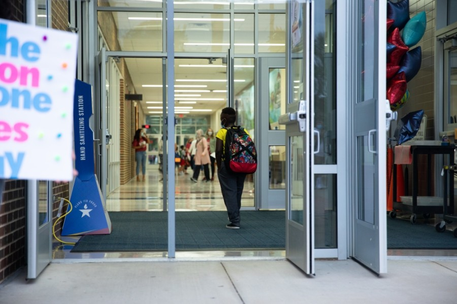 Student walking into school.