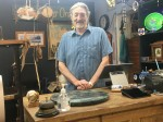 Chuck Ray owns Brows' Aroun' Antiques with his wife, Renee, and son, Cristien. (Haley Morrison/Community Impact Newspaper)