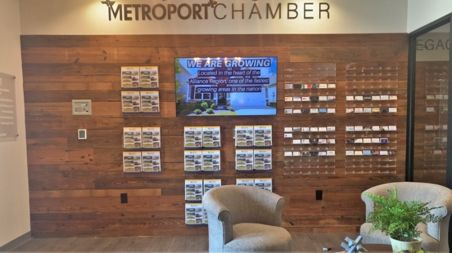 The Metroport Chamber of Commerce lobby allows members to post their business cards on the wall to share. (Sandra Sadek/Community Impact Newspaper)
