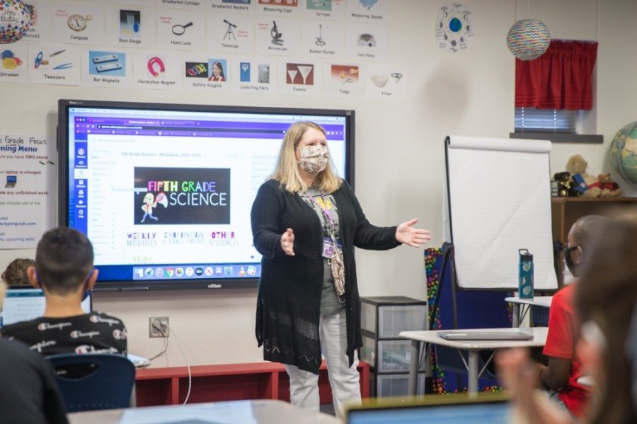 Wolford Elementary School fifth grade teacher Michele McGilvray welcomes students to her class on September 3, 2020. Next school year masks will be optional. (Courtesy McKinney ISD)