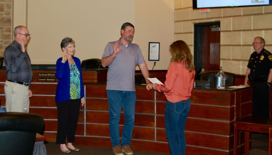 City Secretary Kaylynn Holloway (right) conducts the oath of office May 11 to City Council members, from left: Kevin Hight, Andrea Willott and Andrew Clark. (Greg Perliski/Community Impact Newspaper)