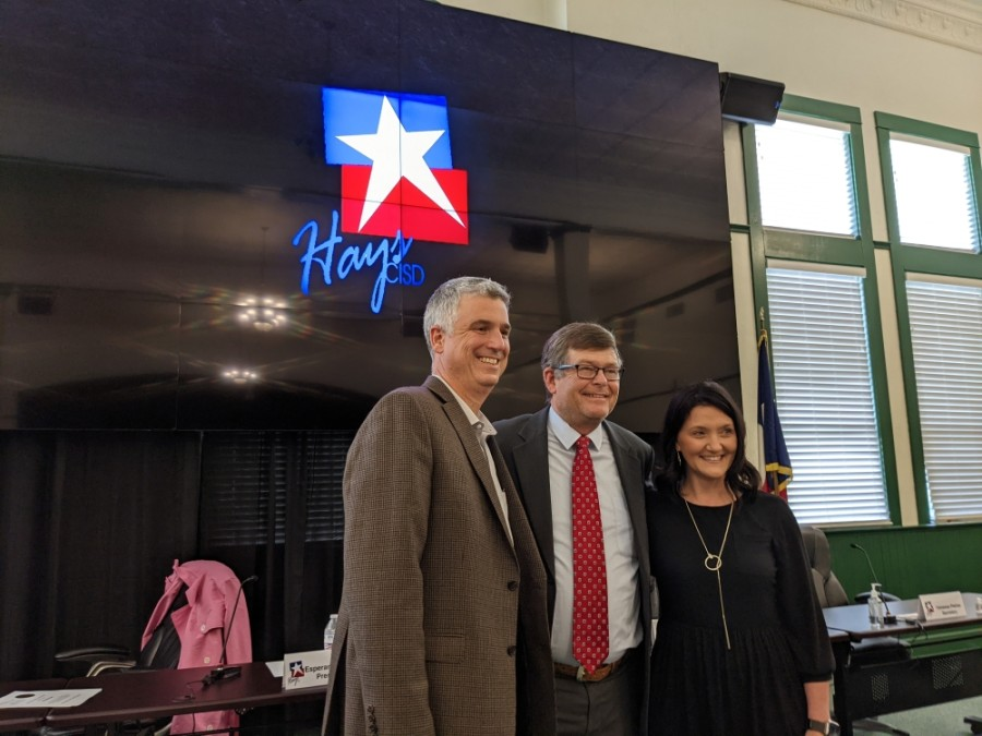 Hays CISD At-Large Trustee Will McManus (left), Hays County Precinct 2 Commissioner Mark Jones (center) and Hays CISD District 3 Trustee Courtney Runkle (right) stand for a photo during a May 17 meeting. (Warren Brown/Community Impact Newspaper)