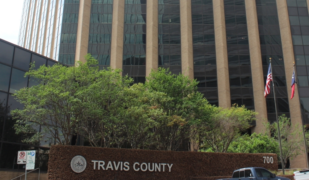 Photo of the Travis County building and sign