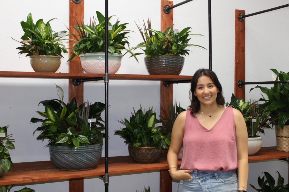 Isabel Ramirez is the manager of Anisa Flower Shop in Magnolia. (Brooke Ontiveros/Community Impact Newspaper)