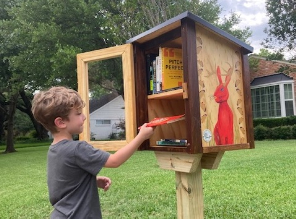 Child at a Little Free Library.