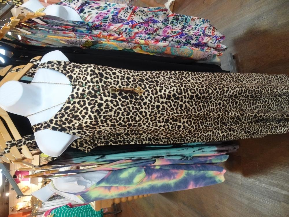The leo maxi dress is a floor-length dress featuring a leopard print pattern ($139.99). (Emily Jaroszewski/Community Impact Newspaper)