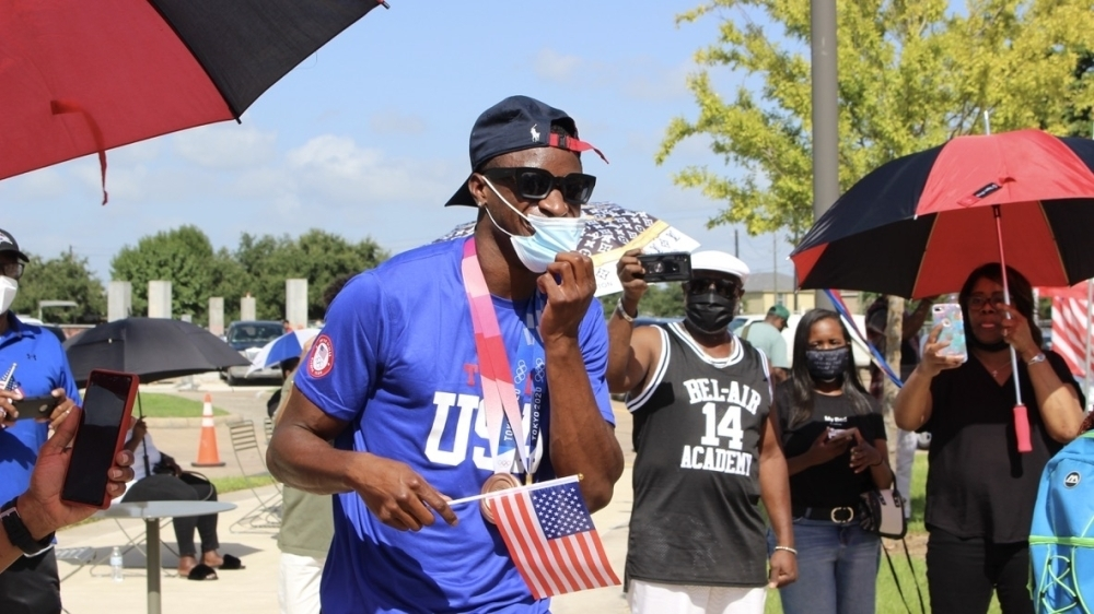 Bryce Deadmon celebrates his Olympic accomplishments with members of the community. (Claire Shoop/Community Impact Newspaper)