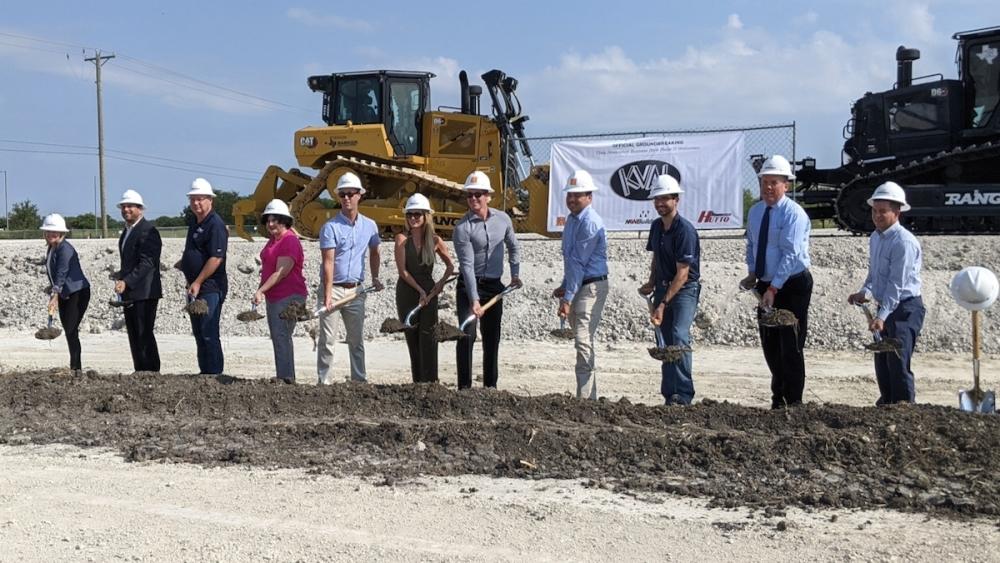 Kval representatives and city officials break ground on the new Kval facility. (Carson Ganong/Community Impact)