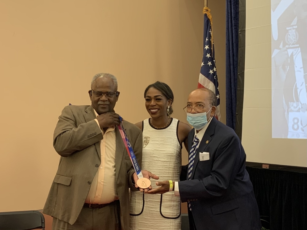 Olympic bronze medalist Raevyn Rogers with Wings Track Club head coaches William Wilmington and B.T. Williams. (Rynd Morgan/Community Impact Newspaper).