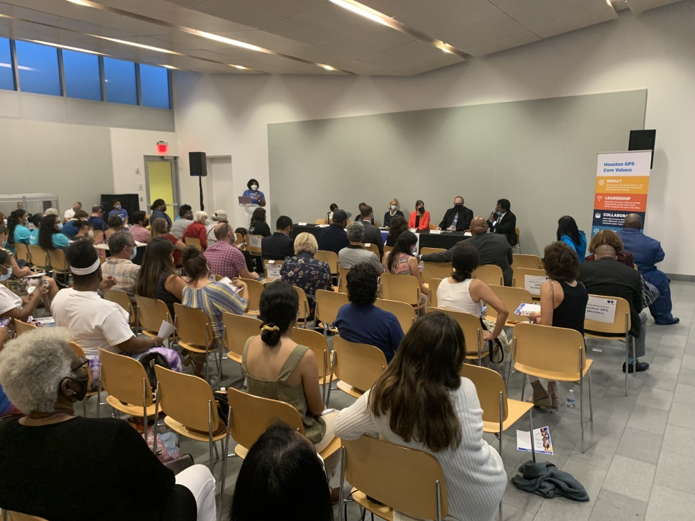 A crowd gathered at Cherie Flores Garden Pavilion at Hermann Park Aug. 26 to hear from candidates running for the Houston ISD board of trustees this November. (Shawn Arrajj/Community Impact Newspaper)