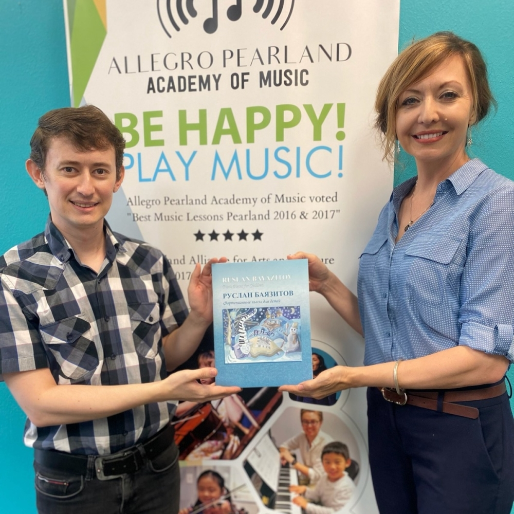 """Ruslan Bayazitov and Heather Scharbor launching the U.S. debut of """"Piano Pieces for Children."""" (Courtesy of Allegro Pearland Academy of Music)"""
