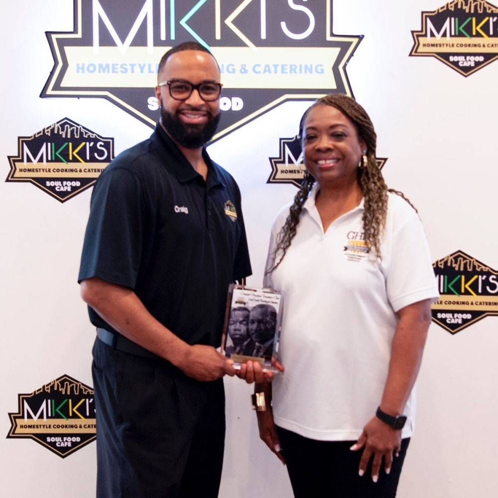 Mikki's Soulfood Café owner Craig Joseph receiving the corporate sponsorship appreciation award from Novella Washington, a member of the Greater Houston Frontier's Club. (Courtesy of the Greater Houston Frontier's Club)