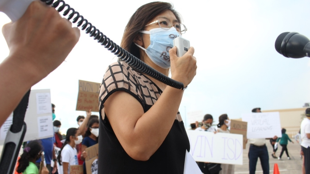 Helen Shih, a scientist and Pearland ISD parent, spoke in favor of a district mask mandate during a rally outside of Pearland ISD's board of trustees meeting on Aug. 16. (Andy Yanez/Community Impact Newspaper)