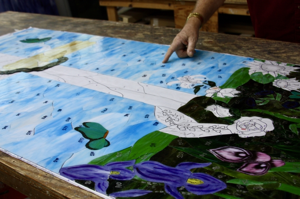 Each piece of glass is cut and laid out in the final pattern to make sure it fits.  (Lauren Canterberry / Community Impact Journal)
