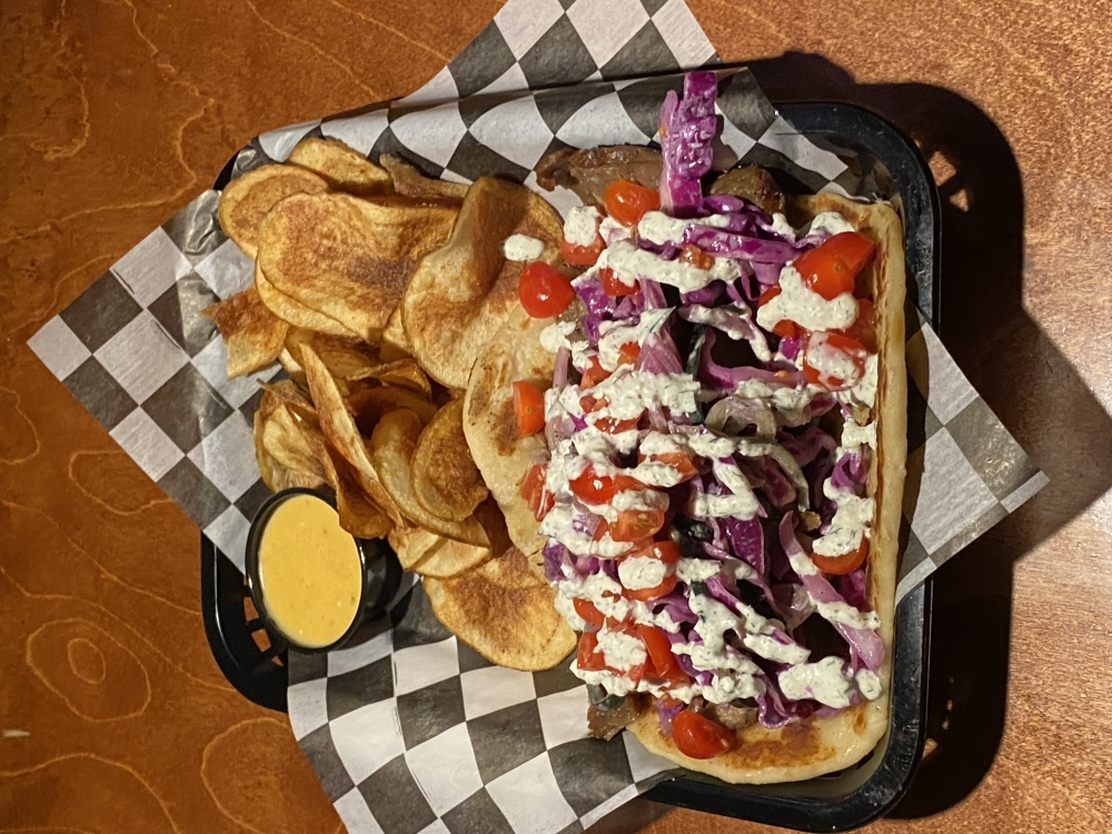 The doner kebab comes with house-made potato chips and beer cheese.
