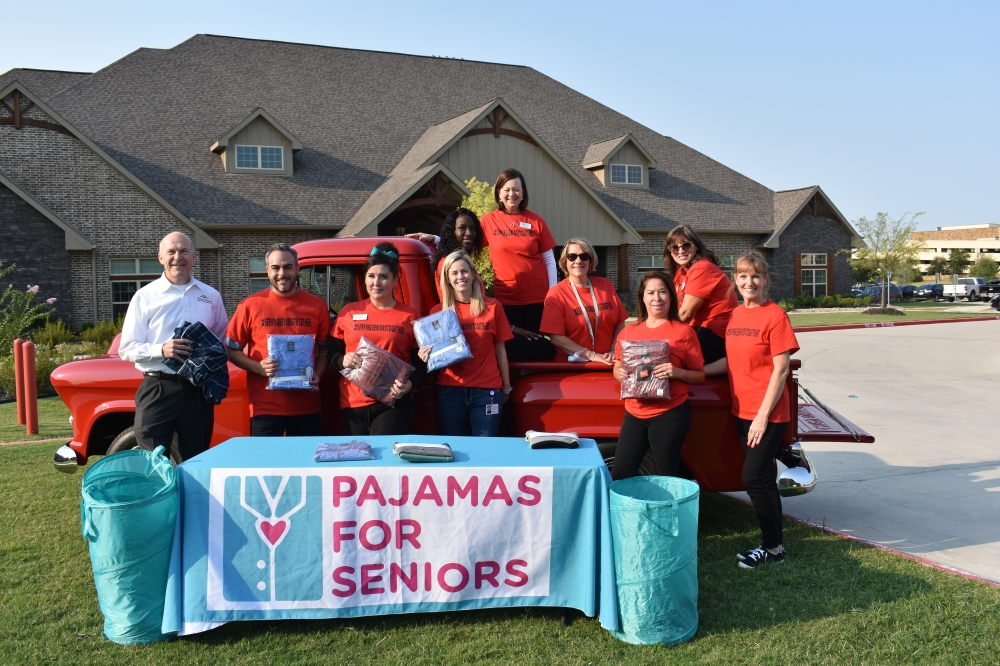 Godwin G. Dixon (far left), co-founder of Teresa's House, an assisted living and memory care home in McKinney, poses with Pajamas for Seniors staff and volunteers. The nonprofit hosted its second annual Grandparents Day Drive at the facility, where they collected pajamas for low-income senior citizens. (Brooklynn Cooper/Community Impact Newspaper)