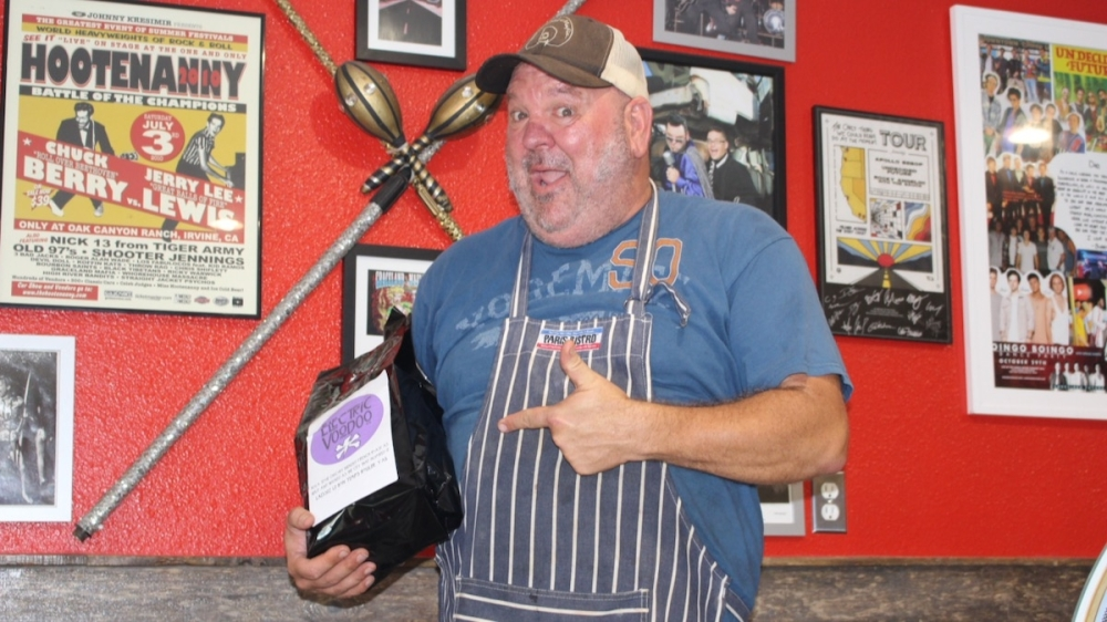 """Damn Fine Coffee and Fried Pies features a wall filled with memorabilia during Jon Mel Jarnagin's days on tour and his time hosting the TV show """"The Food Guys."""" (Andy Yanez/Community Impact Newspaper)"""