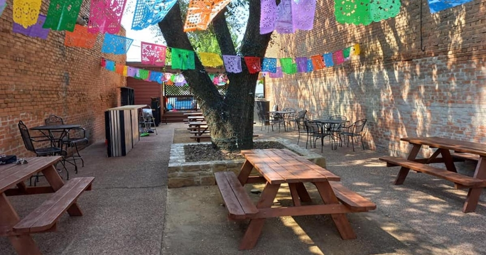 Mexican restaurant with colorful flags outside.