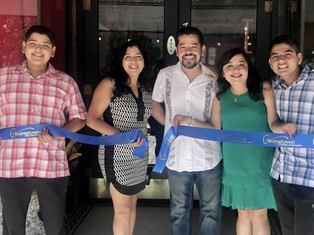 Jorge and Aracely Alcocer, center, opened the Georgetown location of Fuego Latino Gastropub in 2020 with the help of their two sons and daughter. (Courtesy Fuego Latino Gastropub)