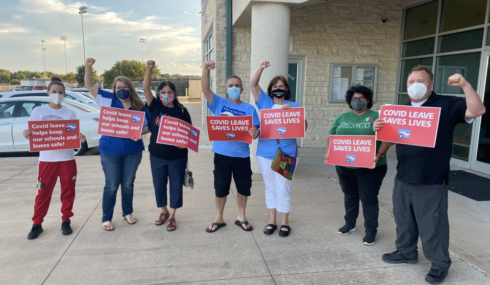 Members of the Pflugerville Educators Association gathered outside the PfISD administration building prior to a Sept. 16 meeting. (Brian Rash/Community Impact Newspaper)
