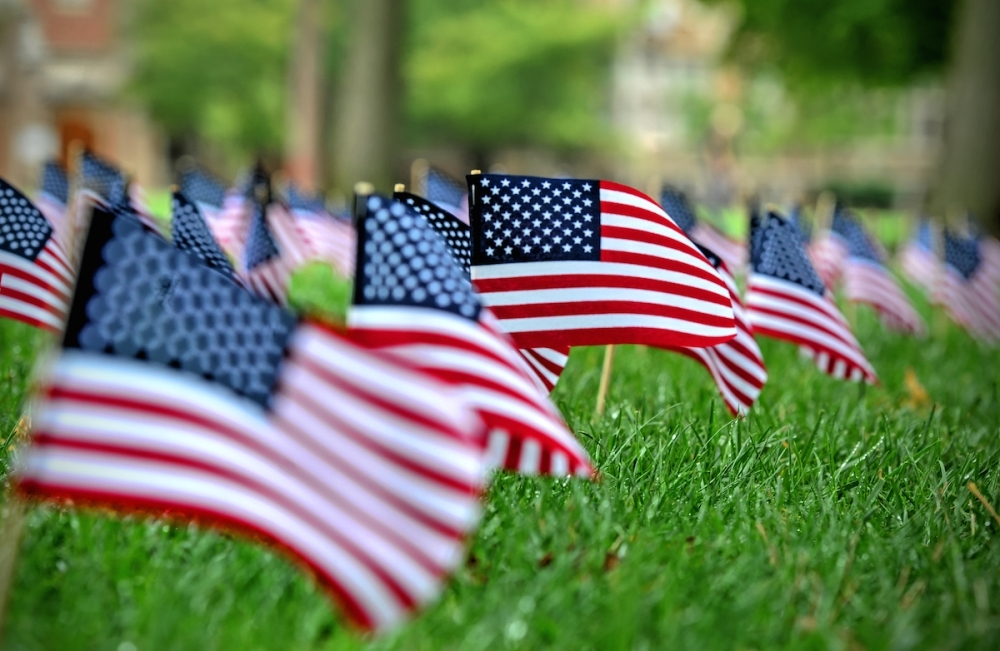 Residents are encouraged to stand along roadways and wave U.S. flags as the motorcade for the Congressional Medal of Honor recipients approaches. (Courtesy Adobe Stock)