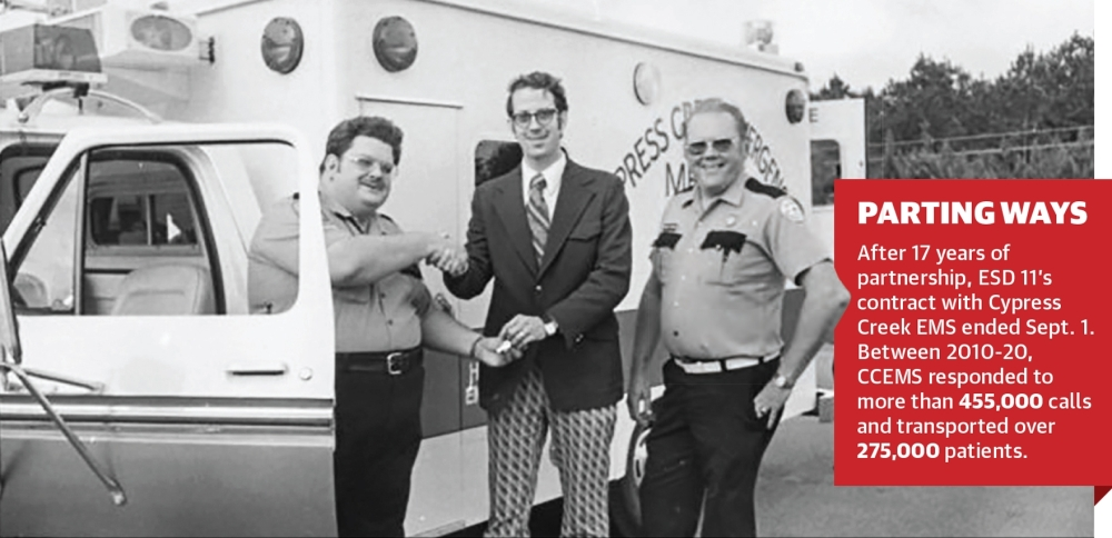 Cliff Woodward (center), co-founder of Cypress Creek Emergency Medical Services, hands the keys of CCEMS' first ambulance to early CCEMS paramedic Richard Beasley (left) in 1975. (Courtesy Cypress Creek EMS)