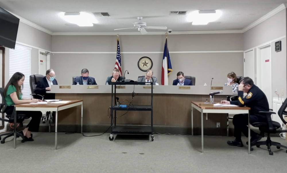 Hill Country Village Mayor Gabriel Durand-Hollis (center right) leads the city council's discussion on the property tax rate for fiscal year 2022 on Sept. 16. (Edmond Ortiz/Community Impact Newspaper)
