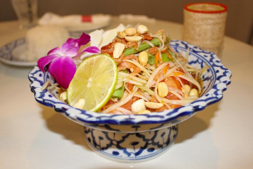 The Thai papaya salad ($9.95) is fresh papaya topped with tomato, long beans, peanuts and salted dry shrimp. (Wesley Gardner/Community Impact Newspaper)