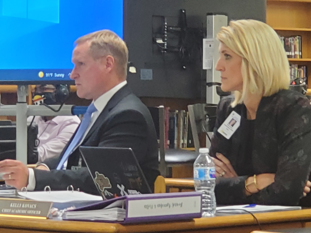 Deputy Superintendent Dr. Damon Edwards and Chief Academic Officer Kelly Kovacs at Sept. 21 Board of Trustees Meeting. (Jarrett Whitener/ Community Impact)