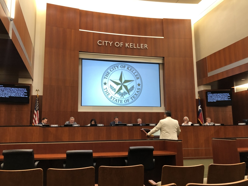 Aaron Rector, director of administrative services for the city of Keller, speaks to the city council about the fiscal year 2021-22 budget and tax rate. (Bailey Lewis/Community Impact Newspaper)