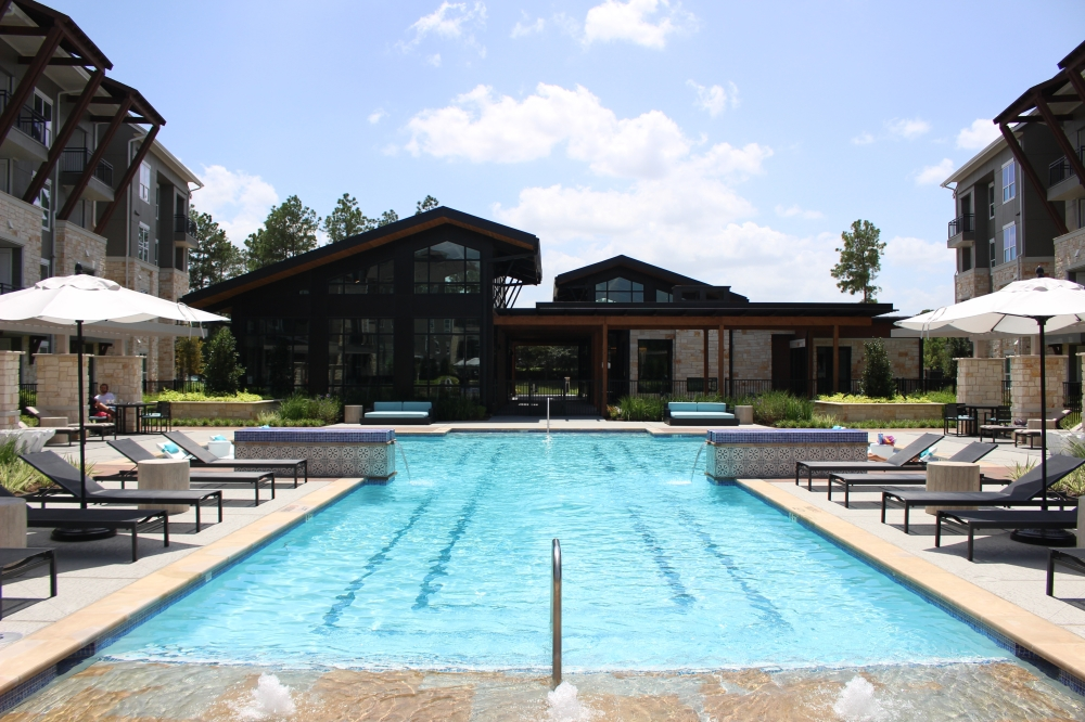 Among the amenities at Creekside Park The Grove is a central resort-style swimming pool with a cabana, wet bar and fireplace near the clubhouse. (Andrew Christman/Community Impact Newspaper)