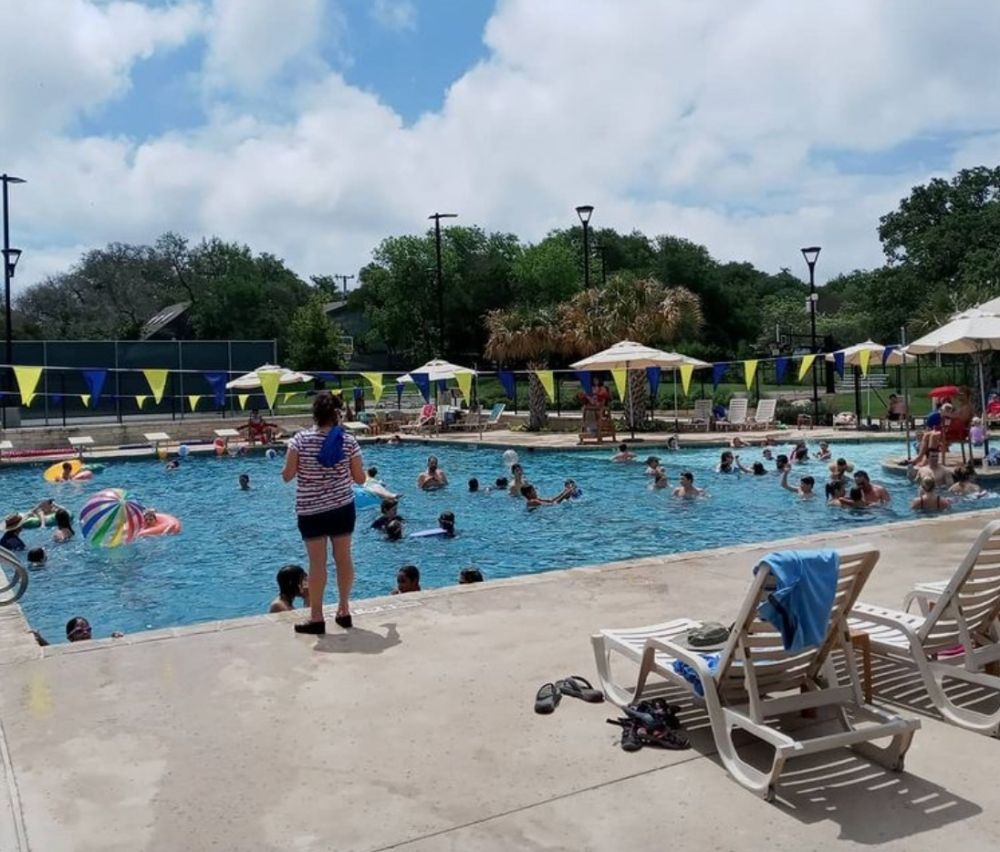 Visitors of all ages enjoy Hollywood Park's public swimming pool at Voigt Park on July 4, 2021. The town of Hollywood Park wants new rules and greater enforcement of user policy at the pool and elsewhere at the park. (Edmond Ortiz/Community Impact Newspaper)