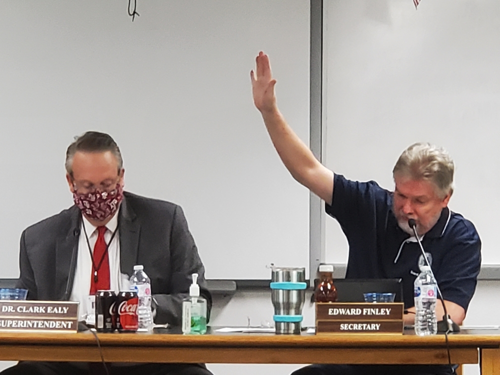SCUCISD Superintendent Clark Ealy and Secretary Edward Finley at the Sept. 21 meeting. (Jarrett Whitener/ Community Impact Newspaper)