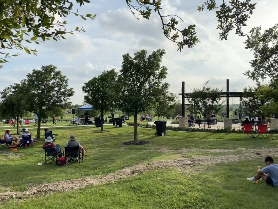 round rock residents watching a movie in yodlers point in old settlers park