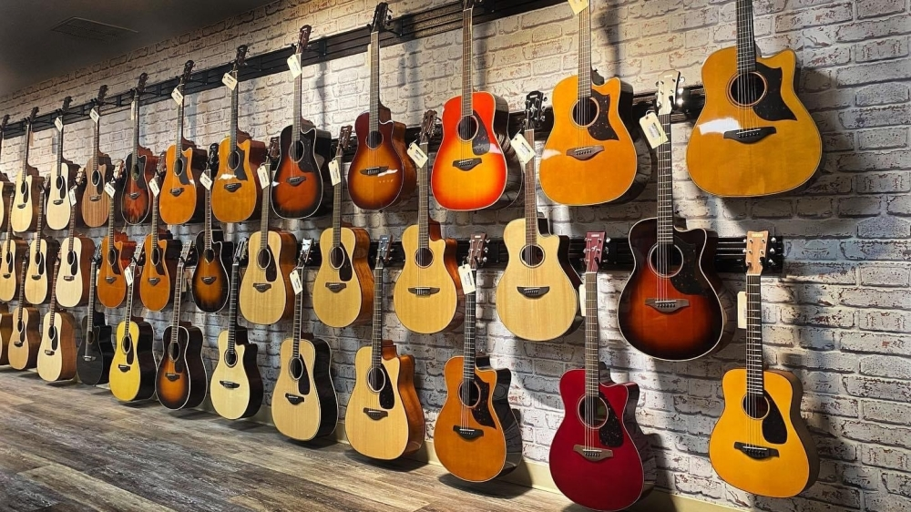 wall of hanging guitars