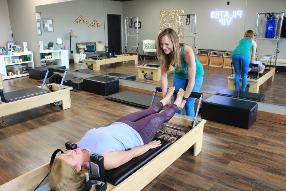 Valerie Lucas, owner of Pilates VIP, demonstrates exercises on the reformer, one of the machines used in pilates. (Sandra Sadek/Community Impact Newspaper)
