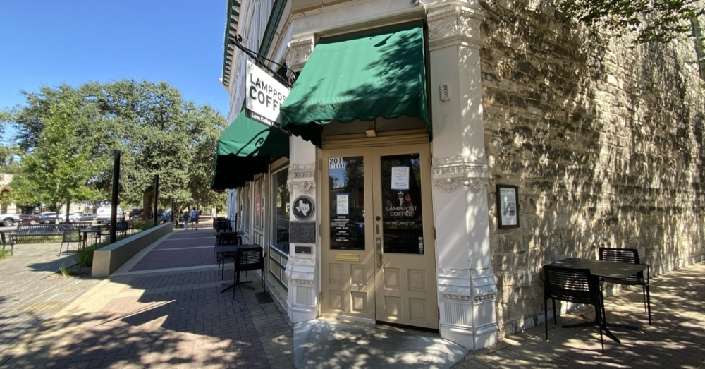 The downtown Round Rock location of Lamppost Coffee will reopen Sept. 27, according to signage recently added to the front door. (Brooke Sjoberg/Community Impact Newspaper)