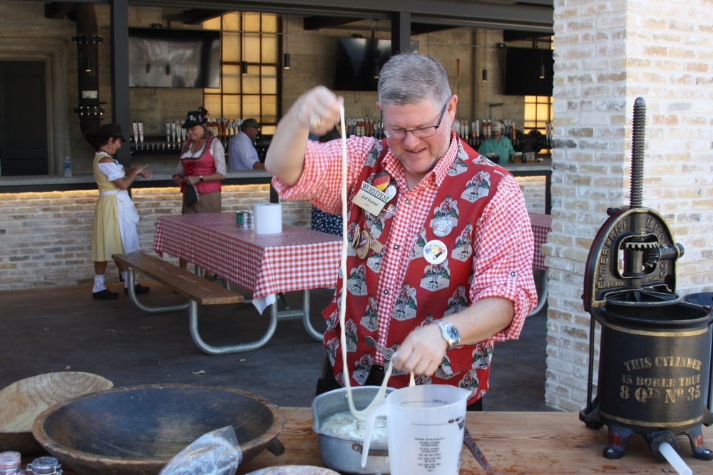 Jeff Goebel, seen here holding sausage casings for a demonstration he gave on traditional sausage making Saturday.