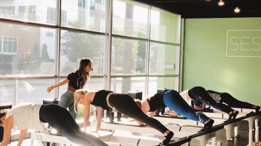 The reformer Pilates studio offers 50-minute classes that focus on quick transitions throughout a beat-based, high-intensity, full-body workout. (Courtesy Session Pilates)