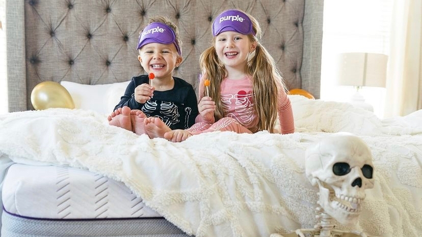 kids smiling on bed