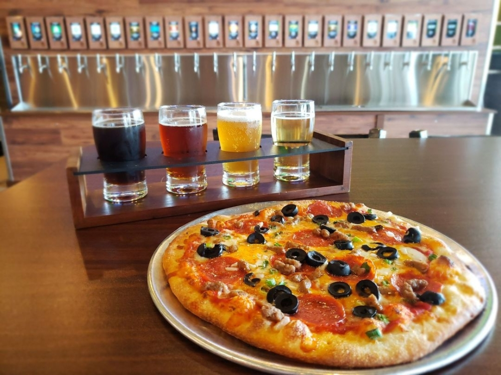 Pizza Artista serves a variety of beers and wine. (Courtesy Pizza Artista)