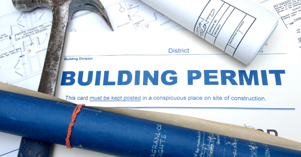 building permits on desk with hammer