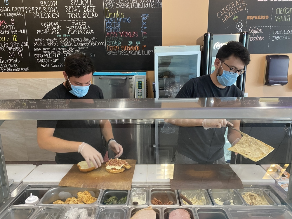 Albert (left) and Agon Demi work together to run the sandwich shop. (Photos by Darcy Sprague/Community Impact Newspaper)