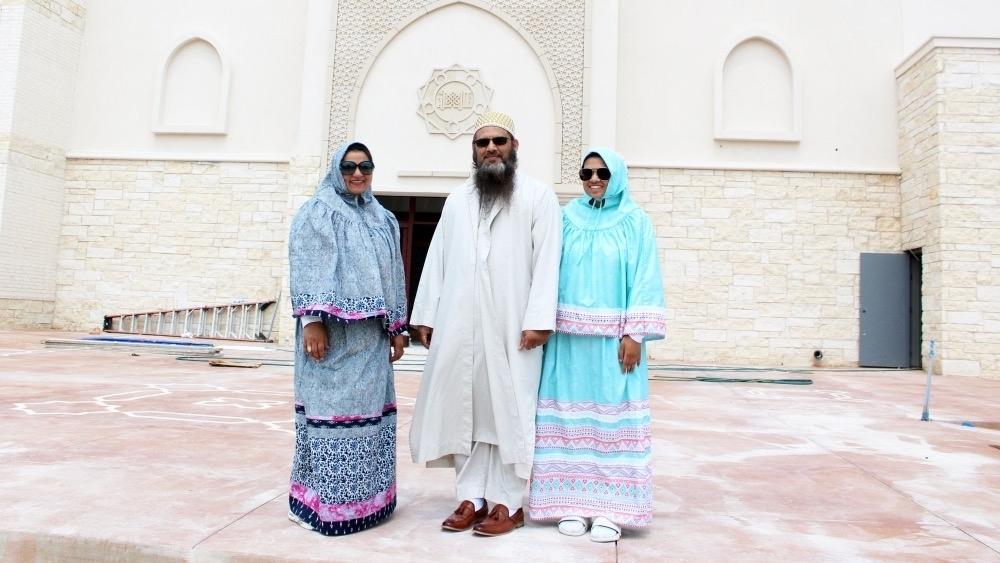 Rashida Rasheed, left, stands in front of the new Masjid with her husband, Shaikh Aliasger Rasheed, and their daughter Sarrah Rasheed. (Karen Chaney/Community Impact Newspaper)