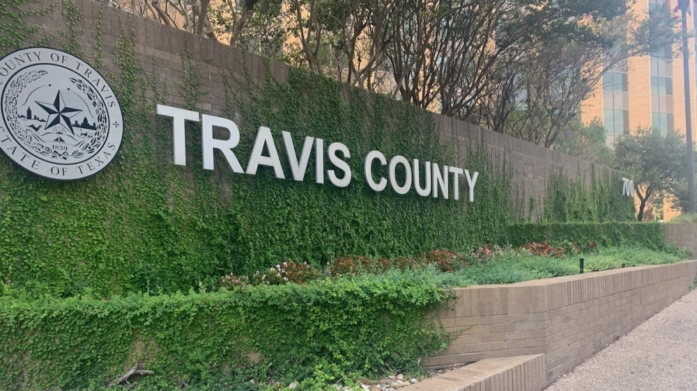 Photo of the Travis County sign