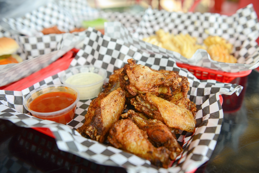 Naked wings start at $7.95 for six and are served with a variety of sauces, such as ghost pepper pineapple. (Ethan Pham/Community Impact Newspaper)