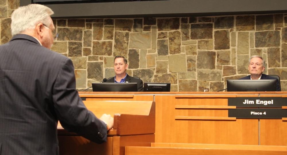 men at council meeting