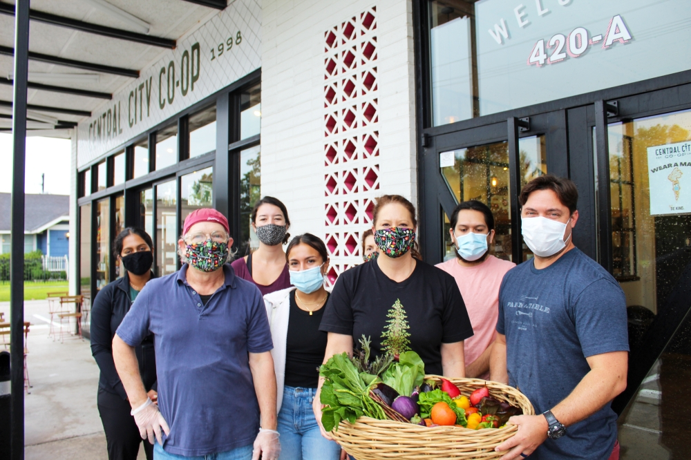 Jessica Wilt (center right) and her team provide customers with packages of farm-fresh goods on a weekly basis. (Photos by Shawn Arrajj/Community Impact Newspaper)