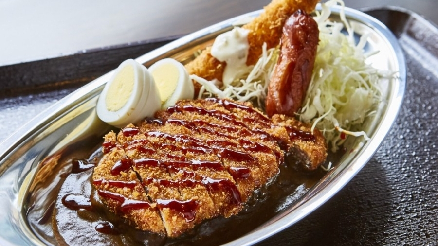 The restaurant serves a Japanese-style brown curry originating from the city of Kanazawa that is characterized by short-grain rice with a side of shredded cabbage and topped with pork or chicken katsu. (Courtesy Go! Go! Curry!)